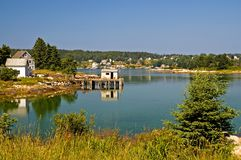 Scenic Maine fishing village. An view of a private homes and a fishing shack on a dock near a scenic fishing village on beautiful and quaint Swans Island, Maine Royalty Free Stock Images