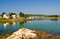 Scenic Maine fishing village. An view of a private homes and a fishing shack on a dock near a scenic fishing village on beautiful and quaint Swans Island, Maine Royalty Free Stock Photos