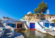 Scenic Mandrakia village traditional Greek village by the sea, the Cycladic-style with sirmata - traditional fishermen`s houses. royalty free stock photos