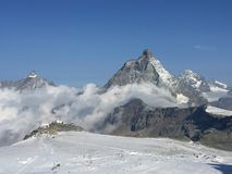 Scenic Matterhorn peak as seen from Breithorn glacier above Zermatt. Scenic Matterhorn peak as seen during ascent to Breithorn peak in Penine Alps on the border Royalty Free Stock Photos