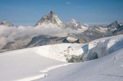 Scenic Matterhorn peak as seen from Breithorn glacier above Zermatt. Scenic Matterhorn peak as seen during ascent to Breithorn peak in Penine Alps on the border Royalty Free Stock Images