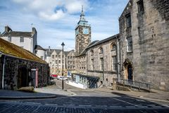 Scenic medieval street with a clock tower in Stirling city center Stock Image
