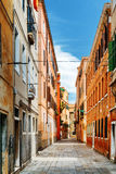 Scenic medieval street at historic centre of Venice, Italy Royalty Free Stock Photography