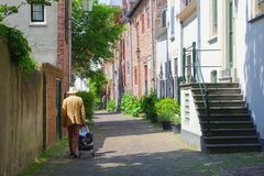 Senior man between scenic medieval Wall Houses,Amersfoort, Netherlands Royalty Free Stock Photography