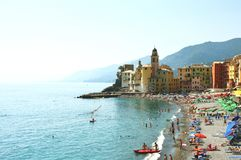 Scenic Mediterranean riviera coast. Panoramic view of Camogli town with Basilica of Santa Maria Assunta and colorful places Stock Photos