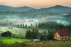Scenic misty morning in the mountains landscape. Photo of misty morning in the mountains. Photo made in Poland stock image