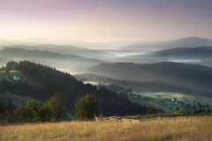 Scenic misty morning in the mountains landscape. Photo of misty morning in the mountains. Photo made in Poland stock photography