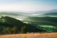 Scenic misty morning in the mountains landscape. Photo of misty morning in the mountains. Photo made in Poland royalty free stock photography