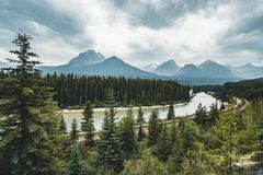 Scenic Morant`s Curve with clouds and trees and mountains, Banff National Park, Alberta Canada royalty free stock image