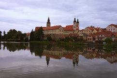 Scenic morning view of medieval Telc at sunrise. Buildings are reflected in the water. Famous touristic place and travel destination in Europe. A UNESCO World royalty free stock photography