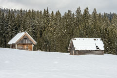 Scenic mountain cottage during winter time Royalty Free Stock Images