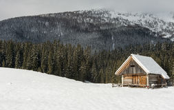 Scenic mountain cottage during winter time Stock Photo