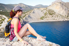 Scenic mountain landscape , sitting girl. Scenic mountain landscape with sea views with sitting girl Royalty Free Stock Image