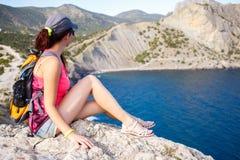 Scenic mountain landscape, sitting woman Stock Image