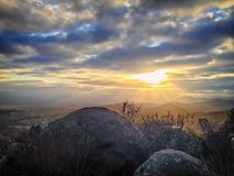 Scenic Mountain Landscape at Sunrise with Dramatic Colorful Clouds Royalty Free Stock Images