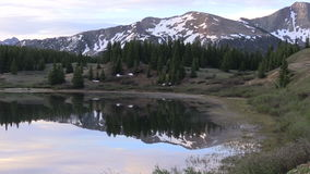 Scenic Mountain Reflection in Sunrise. A scenic reflection of the Colorado mountains in summer stock video footage