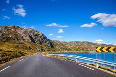 Scenic mountain road in Norway Scandinavia. Scenic mountain road along a lake, Vest-Agder county, Norway, Scandinavia stock images