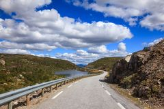 Scenic mountain road in Norway Scandinavia. Scenic mountain road along a lake, Vest-Agder county, Norway, Scandinavia stock photo