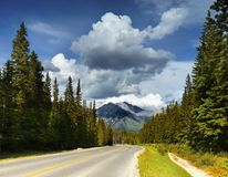 Scenic Mountain Road, Canadian Rockies. Mountain scenic road in Banff and Jasper National Parks. Canadian Rockies, Alberta. Canada Royalty Free Stock Photography