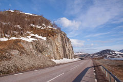 Scenic mountain road on sunny day. Riksgransen Sweden Stock Image