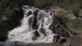 Scenic Mountain Waterfall. A scenic small mountain waterfall in Colorado in summer stock footage
