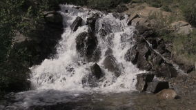 Scenic Mountain Waterfall in Summer. A scenic small mountain waterfall in Colorado in summer stock video