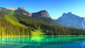 Canadian Rockies and Lake, Sunrise Scenery. Scenic mountains and Emerald Lake shore in Canadian Rockies. Canadian landscape, sunrise scenery. British Columbia stock photography