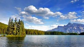 Canadian Rockies and Lake, Banff NP, Sunrise Scenery. Scenic mountains and lake in Canadian Rockies. Canadian landscape, Banff NP. Summer sunrise scenery stock photo