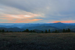 Scenic mountains sky trees horizont summer evening Stock Photography