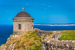 The scenic Mussenden Temple on the Cliffs stock photography