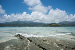 Scenic Mystery Island Nautical Tour. MYSTERY ISLAND, VANUATU, PACIFIC ISLANDS-DECEMBER 2,2016: Nautical vessel touring around the tropical mountain landscape and Royalty Free Stock Images