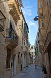 Malta, Three Cities, Narrow, scenic Middle Ages street in L-Isla, Valletta. Scenic, narrow Medieval street and buildings in L-Isla, one of the Three Cities stock images