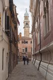 Narrow street in Venice royalty free stock images