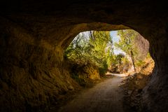 Scenic natural rock tunnel on the mountain trail Valley, Cappadocia, Turkey royalty free stock images