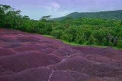 Scenic Natural Wonder of Chamarel plain at Mauritius. This image is taken when the purple violet hue is at the strongest moment. Also known as Seven Coloured royalty free stock photography