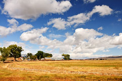 A scenic nature farmland landscape with clouds Royalty Free Stock Photo