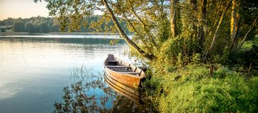 Scenic nature landscape near lake. Rowing boat in summer morning Royalty Free Stock Photos