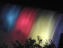 Scenic Niagara Falls, Ontario, Canada. Scenic Niagara Falls, colored illumination at night, as a background, Ontario, Canada Stock Images