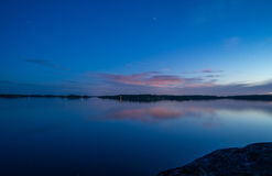 Scenic night time view on sea. View on Stockholm Archipelago during night time with stars stock photo