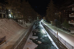 Scenic night time views of Zermatt (and frozen river), Switzerland.  Royalty Free Stock Photography