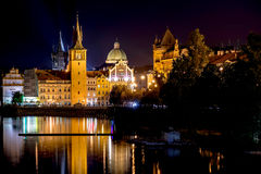 Scenic night view of Charles Bridge and buildings along the Vlta Stock Photos