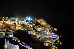 A scenic night view of the city of Thira in Santorini with its l stock photography