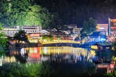 Scenic night view of colorful lights reflected in lake, Yangshuo royalty free stock photo