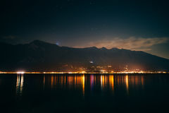 Scenic night view of illuminated town on Garda lake, Italy Royalty Free Stock Photo