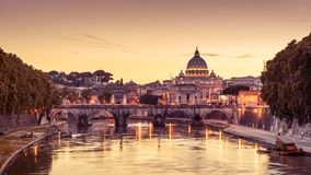 Scenic night view of Rome and Vatican. Rome at night, Italy. Sant`Angelo bridge and St Peter`s Basilica. Rome landmark. Saint Peter`s Basilica San Pietro is one stock image