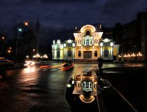 Scenic nightscape of Cherkasy, Ukraine. Illuminated Scherbyna's mansion - Wedding Palace. Historical building of old city and one of the most famous stock photo