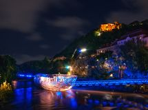 Scenic nightscape of Murinsel bridge on River Mur and illuminated castle in Graz, Austria.  stock photography