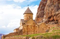 Scenic Novarank monastery in Armenia. Noravank monastery was founded in 1205. It is located 122 km from Yerevan in  narrow gorge. Scenic Novarank monastery in Royalty Free Stock Photo