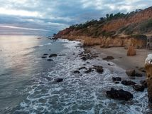 Scenic ocean beach with rocks in Malibu, California.  Stock Photography