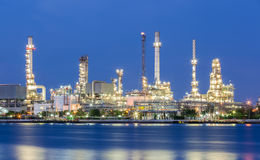 Scenic of oil refinery plant of Petrochemistry industry in twili. Ght time and reflection in near river in Bangkok, Thailand Stock Image